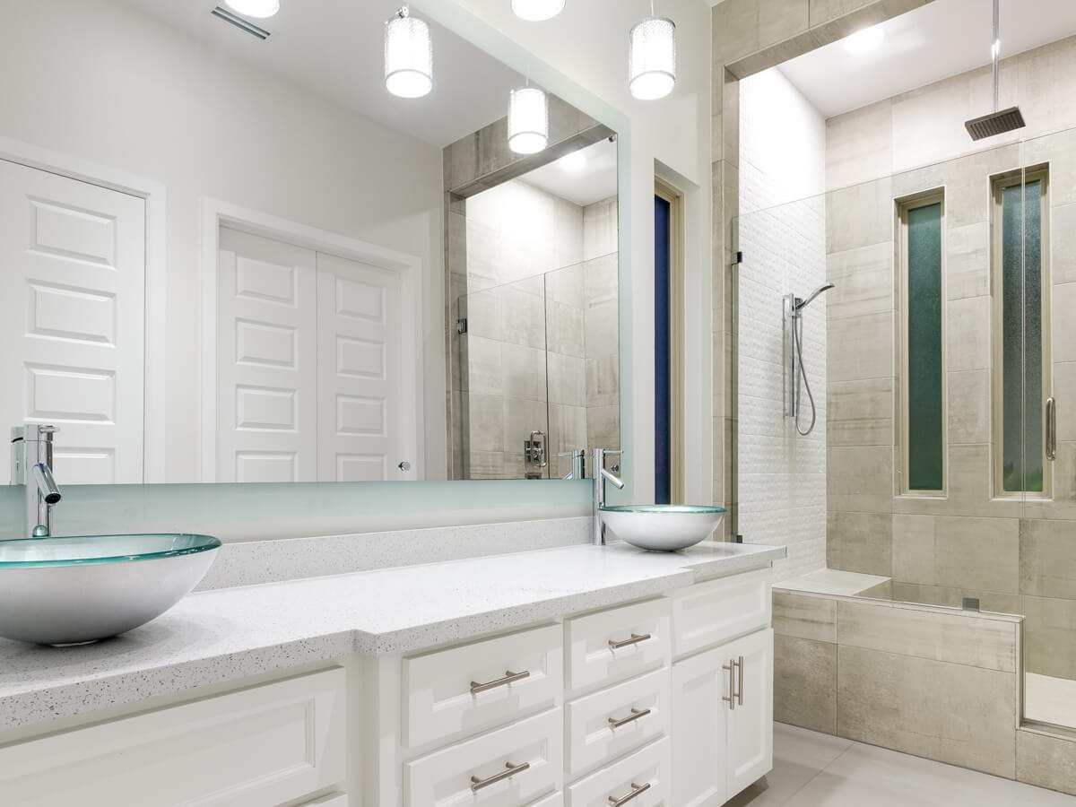 Bathroom interior white with wide mirror and two faucets