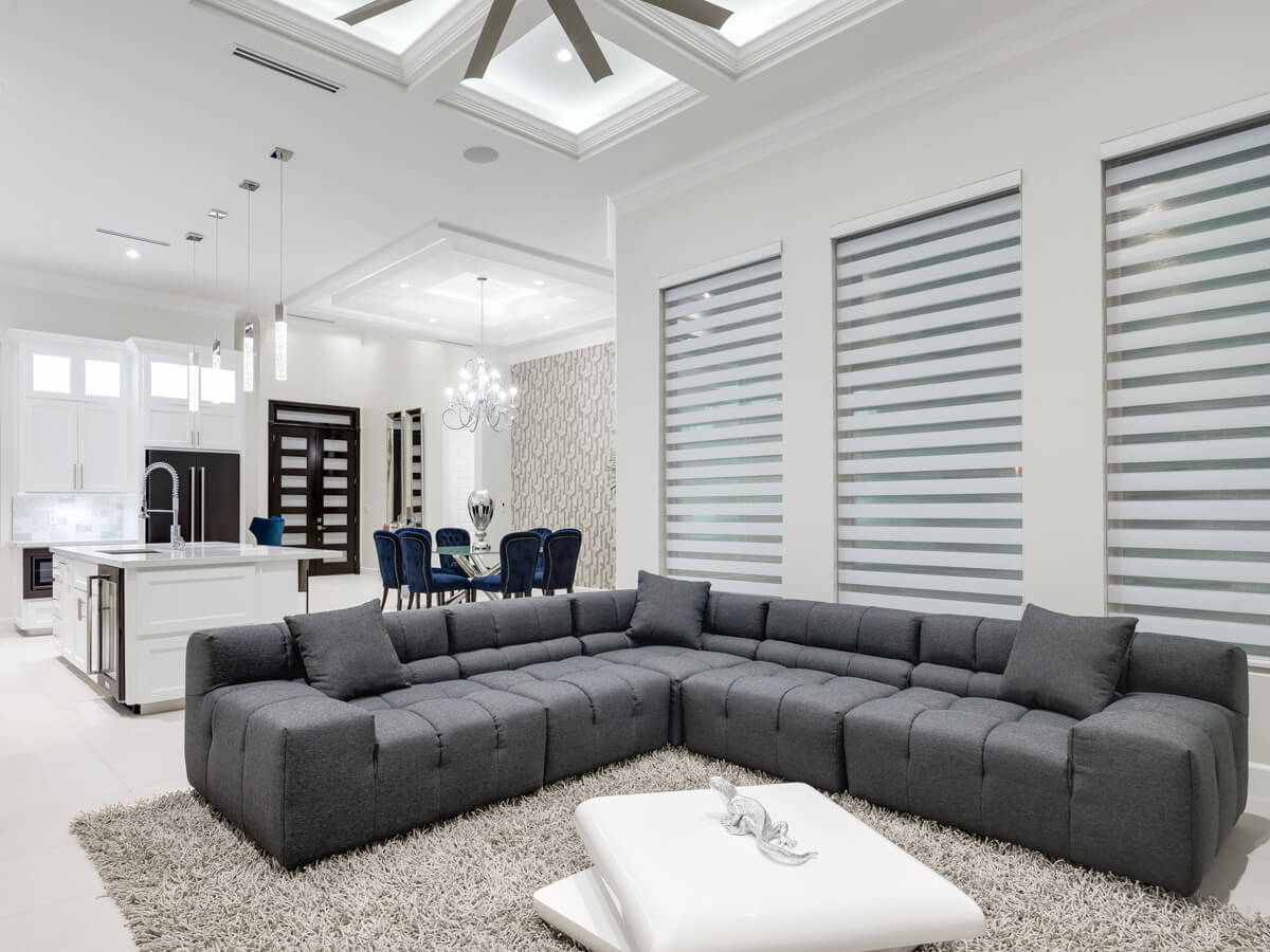 Living room interior with grey coaches, and large fan