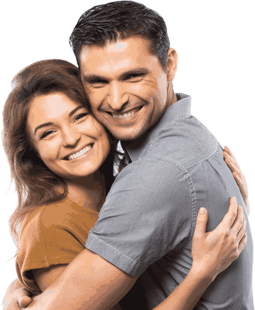 Man and woman in their 30s hugging each other and smiling
